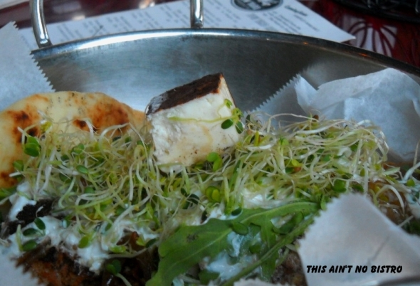 Close up showing a cube of paneer.